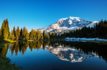 Washington's Mt. Rainier reflects in the water.